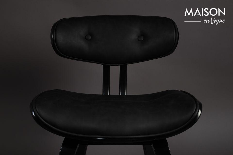 Het frame in zwart gelakt notenhout voegt een vleugje elegantie toe aan het geheel