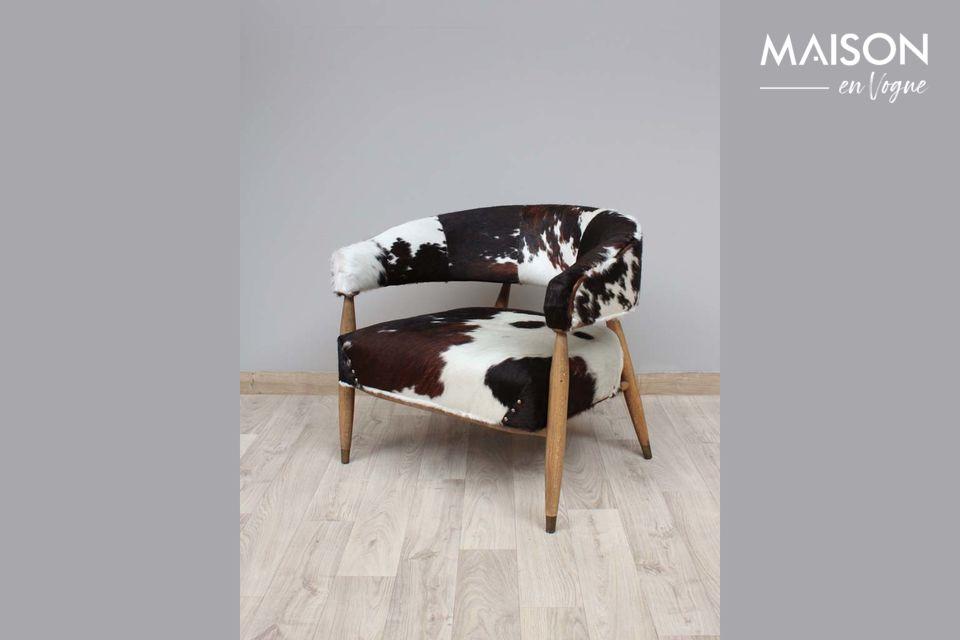 Les Rocheuses koe en eikenhouten fauteuil