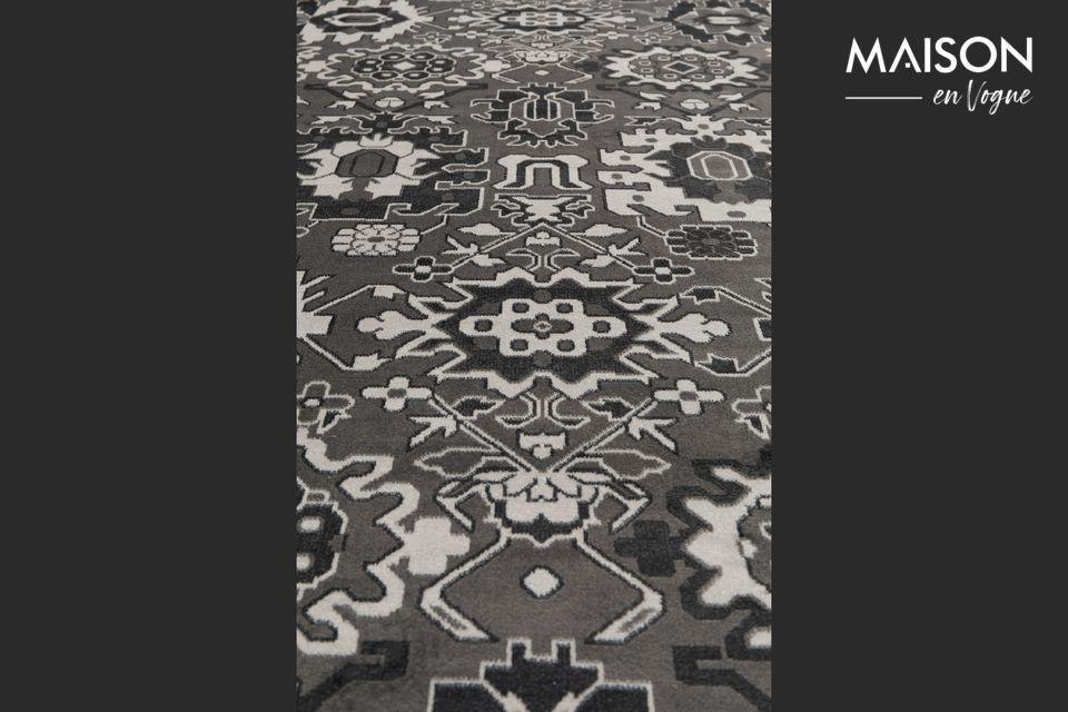 Op dit geweven tapijt met geborstelde en geschoren afwerkingen ontdekt u een set moderne en