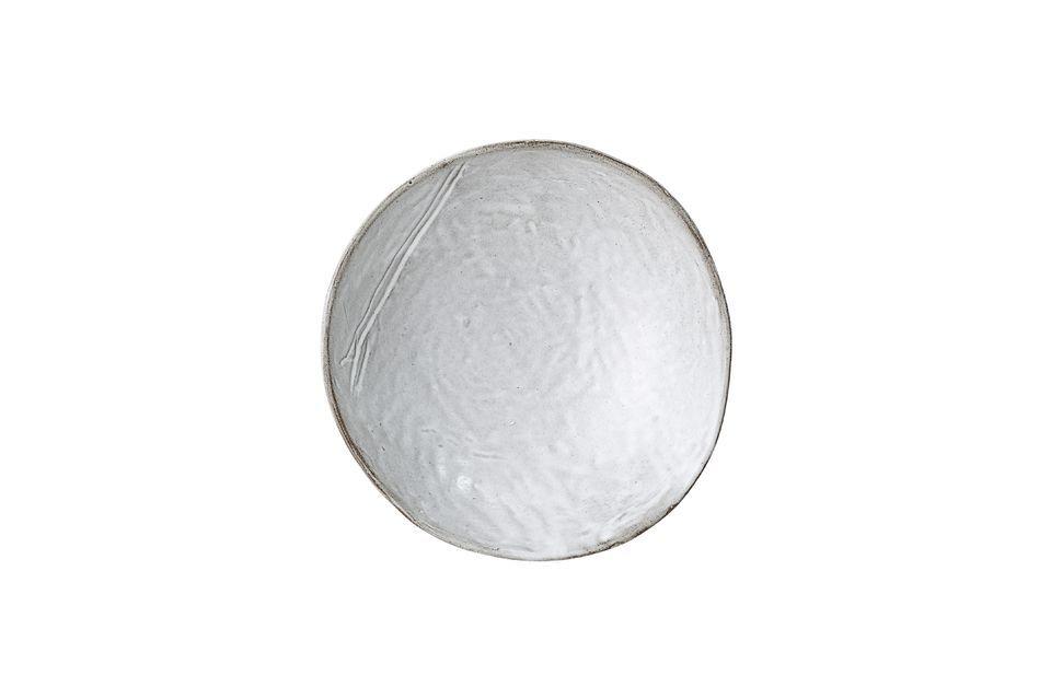 Deze grijze steengoedschaal onderscheidt zich met zijn asymmetrische rand van het gewone en zal niet